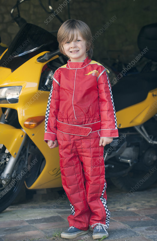 Boy wearing race car driver costume
