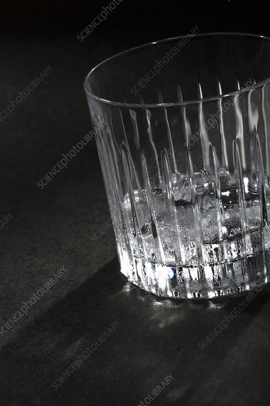 Empty glass of ice on table
