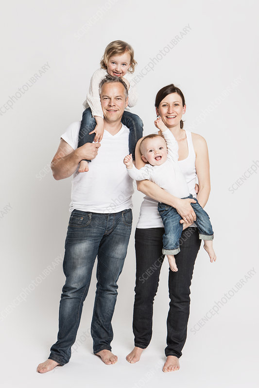 Smiling family posing together