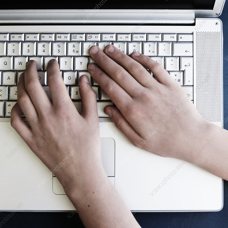 Close up of hands using laptop