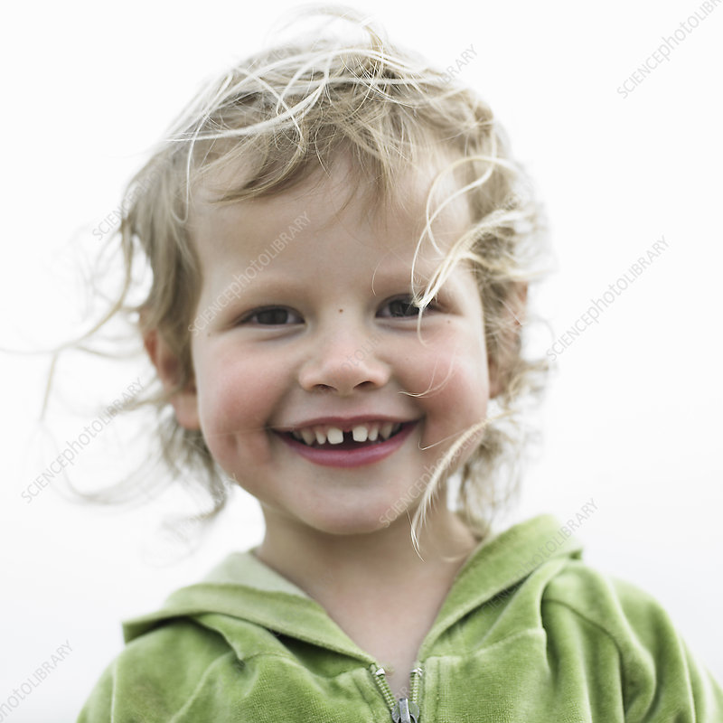 Close up of toddler girls smiling face