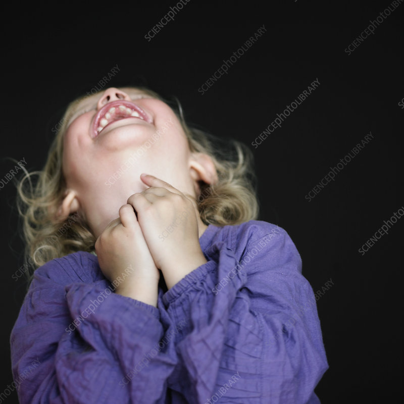 Close up of toddler girl laughing