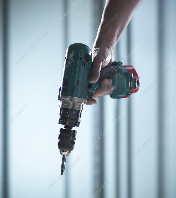 Close up of hand holding power drill