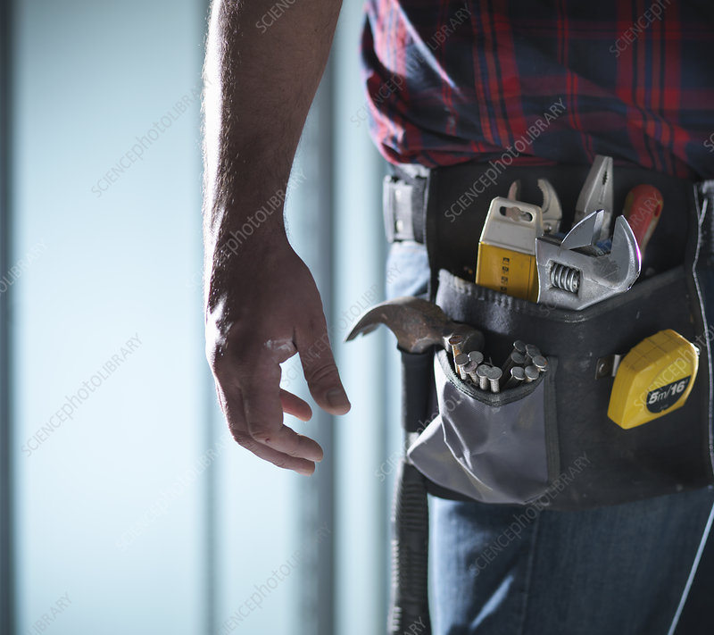 Close up of worker wearing tool belt