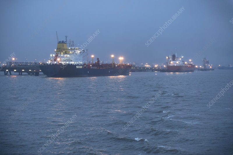 Tanker ships lit up at night