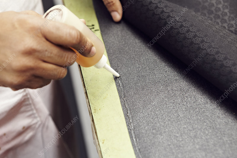 Close up of hands gluing fabric