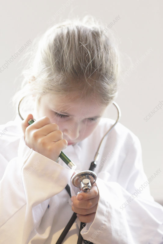 Girl playing doctor with stethoscope