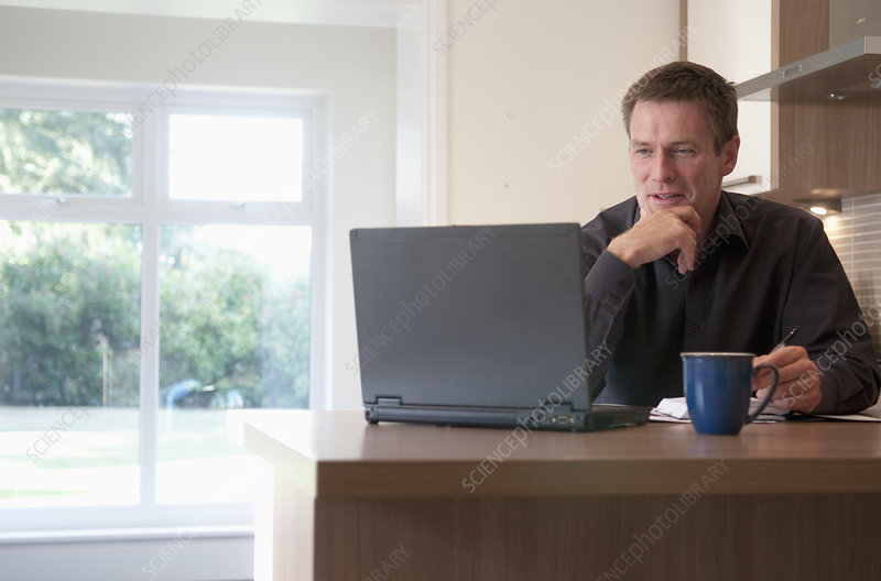 Businessman working on laptop at desk