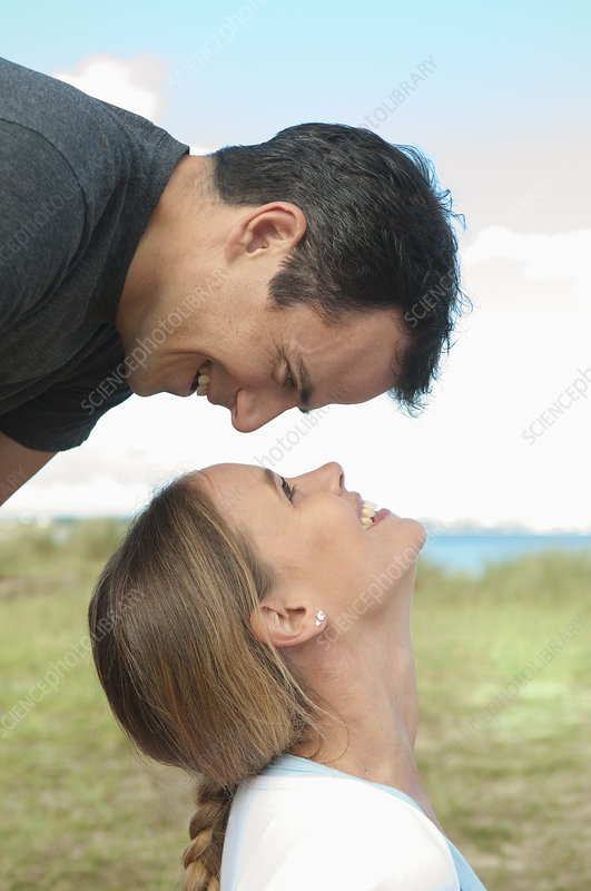 Couple smiling at each other outdoors