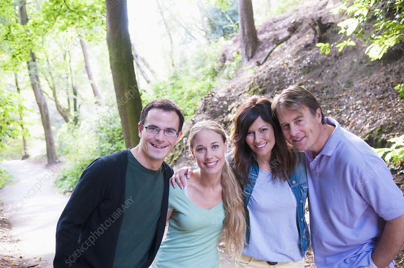 Couples smiling together in forest