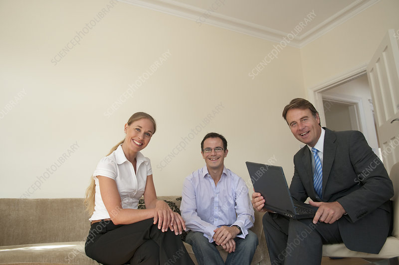 Business people sitting in living room