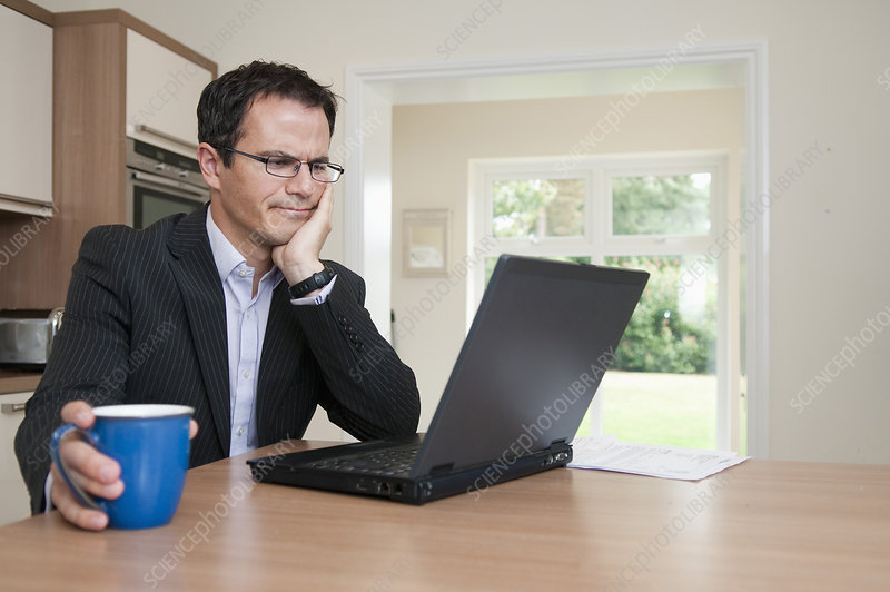 Businessman using laptop at breakfast