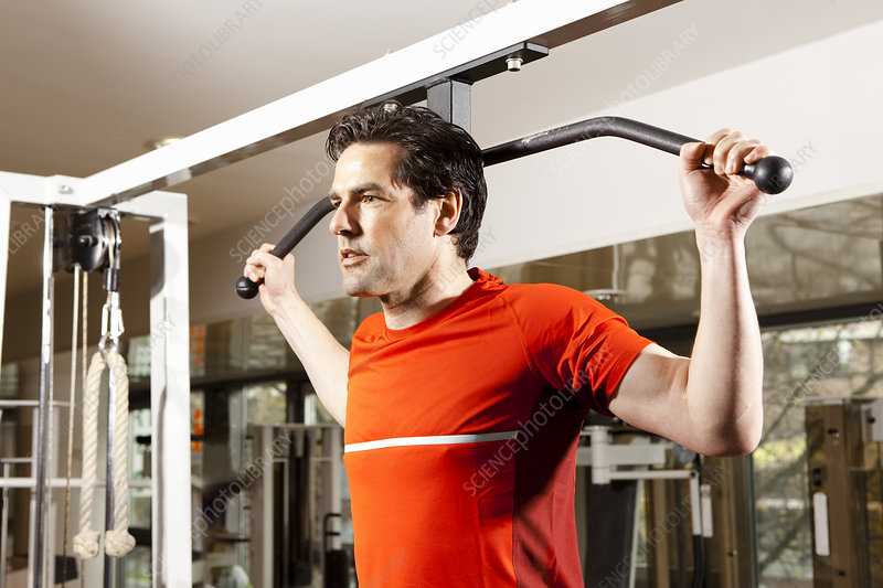 Man using exercise equipment at gym