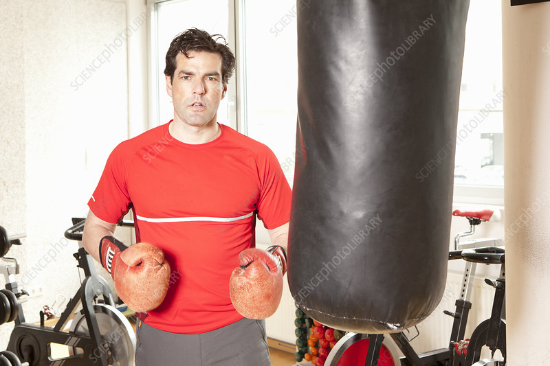 Man using punching bag at gym