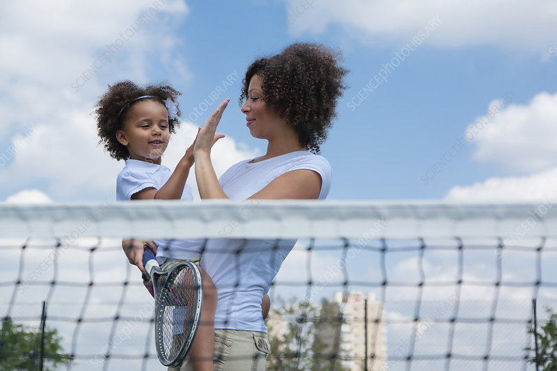 Mother and daughter high fiving on court