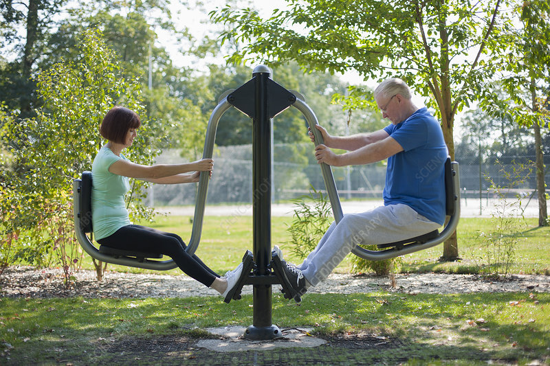 Older couple using exercise equipment