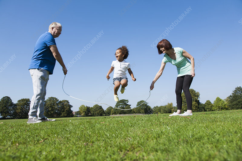 Older couple playing with granddaughter