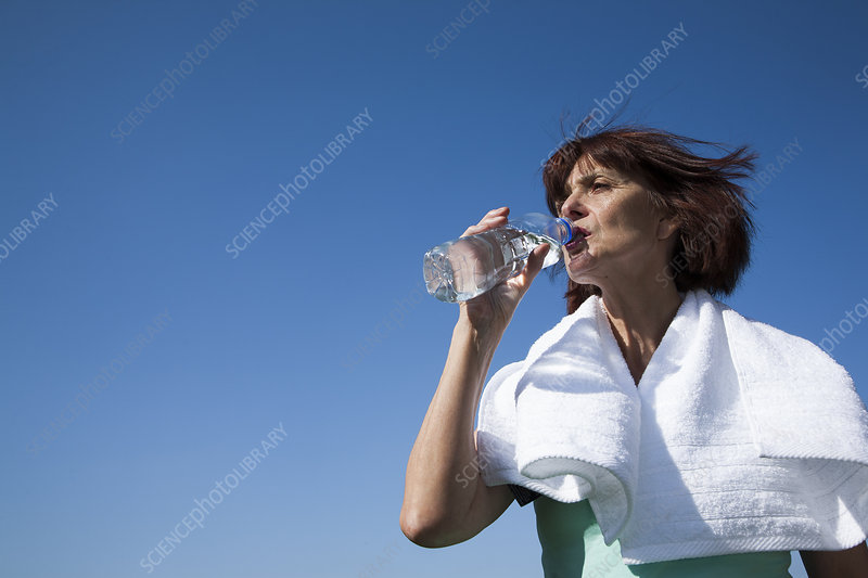 Older woman drinking water bottle
