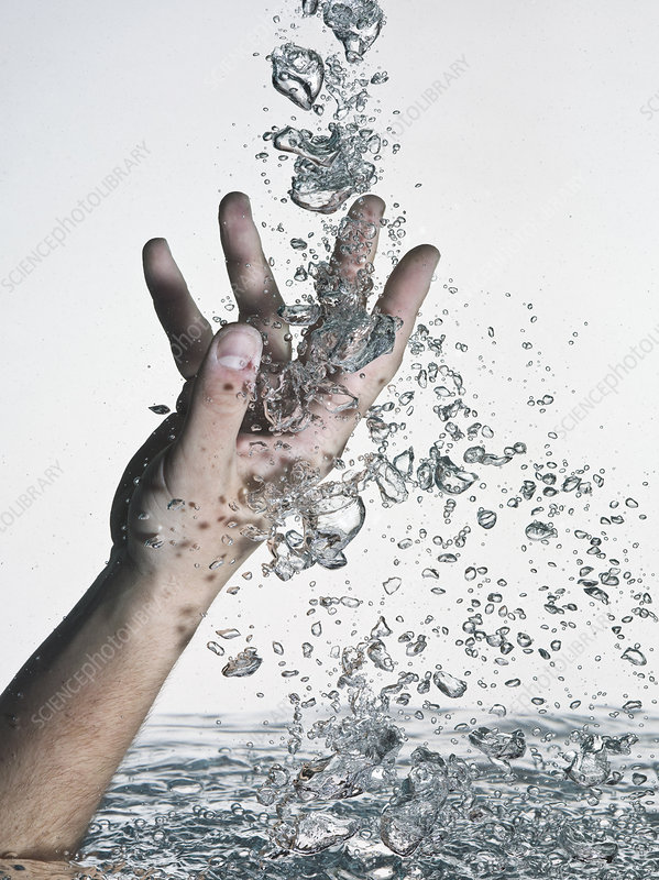Hand thrust into water