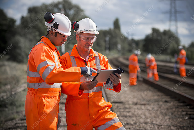 Railway workers using tablet computer