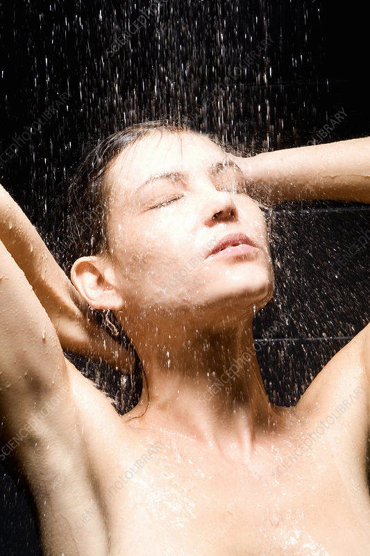 Woman rinsing her hair in shower