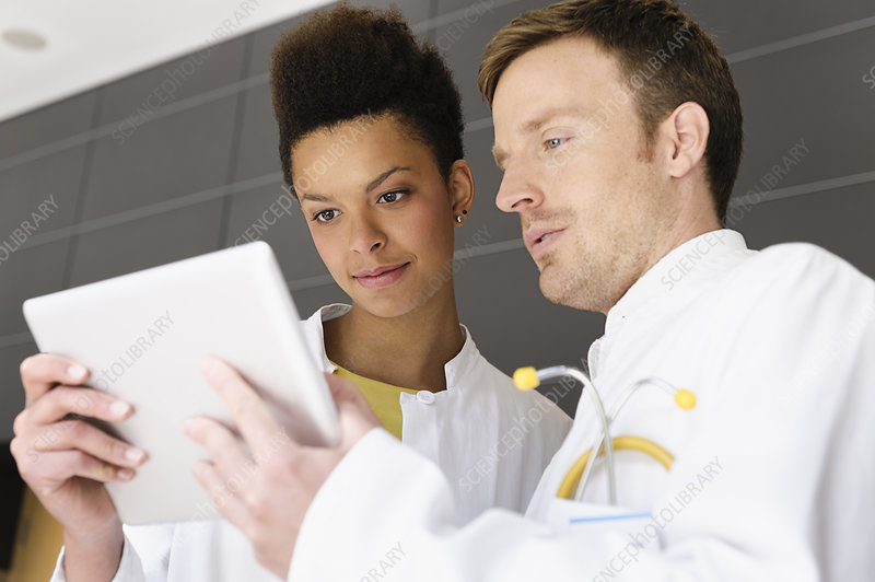 Doctor and patient with tablet computer