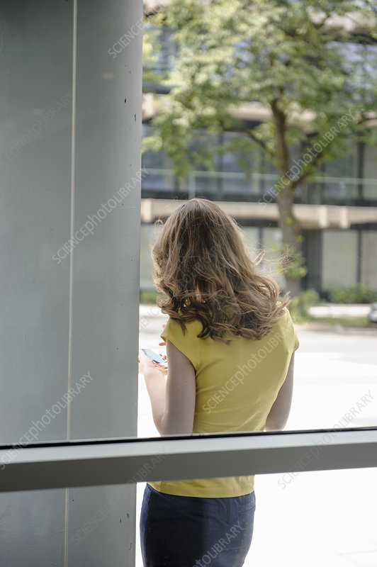 Woman leaning against window