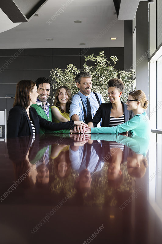 Business people smiling at table