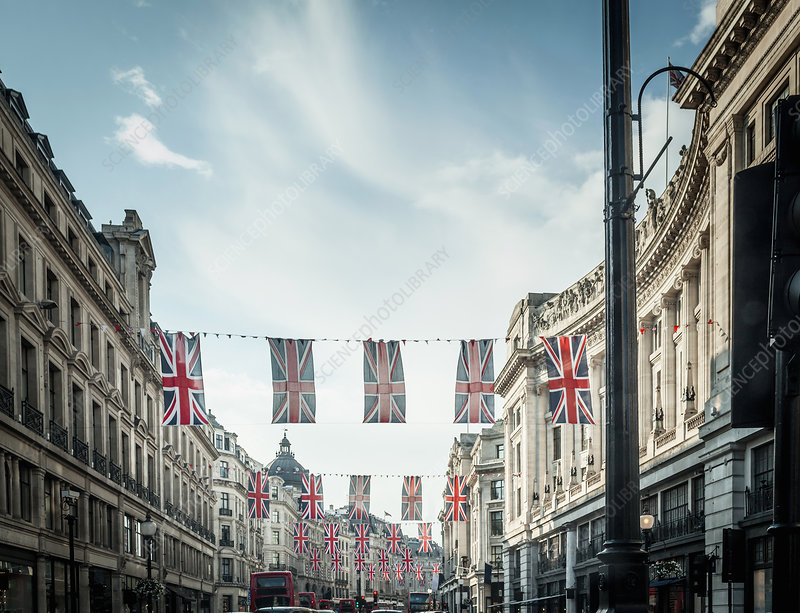 British flags hanging over city street