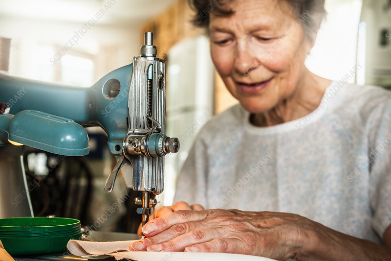 Older woman working on sewing machine
