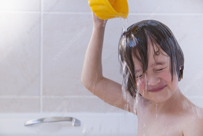 Girl washing her hair in bath