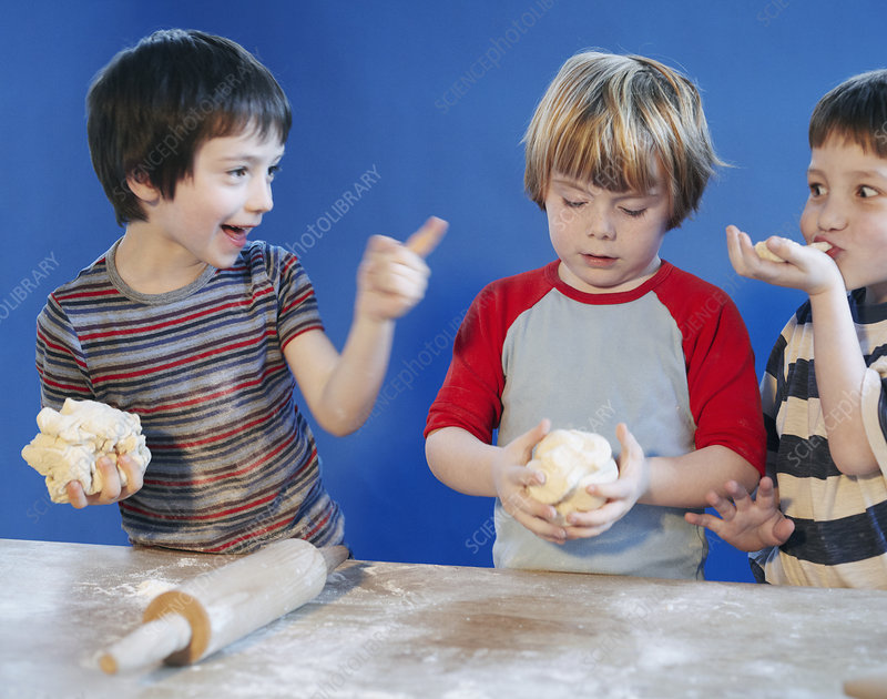 Boys playing with dough