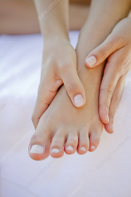 Close up of woman rubbing her foot