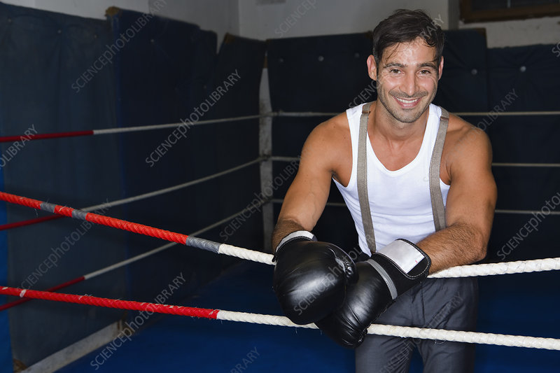 Smiling boxer standing in ring