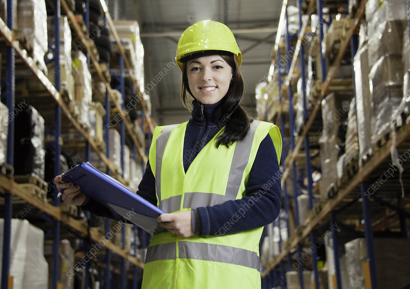 Worker holding clipboard in warehouse