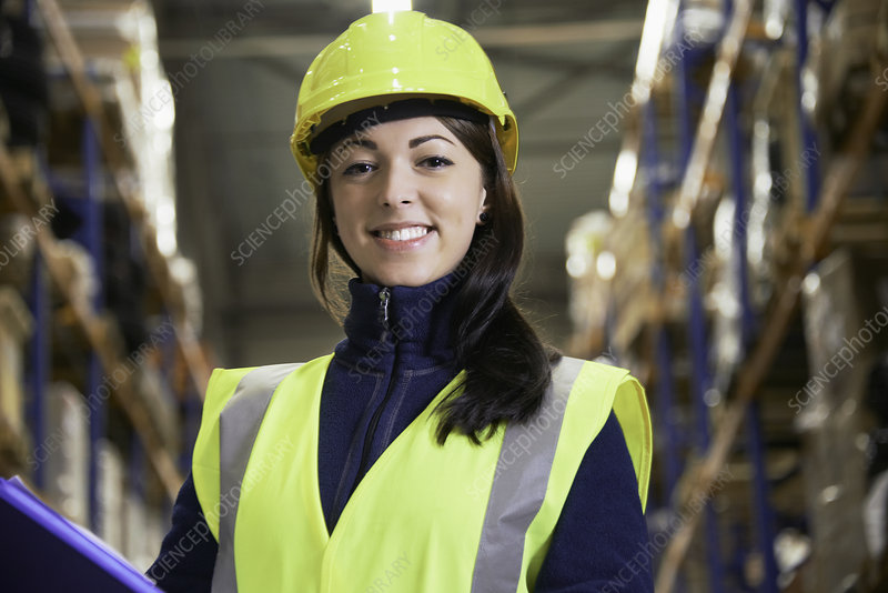 Smiling worker standing in warehouse