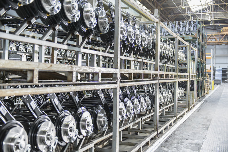 Shelves of axles in car factory