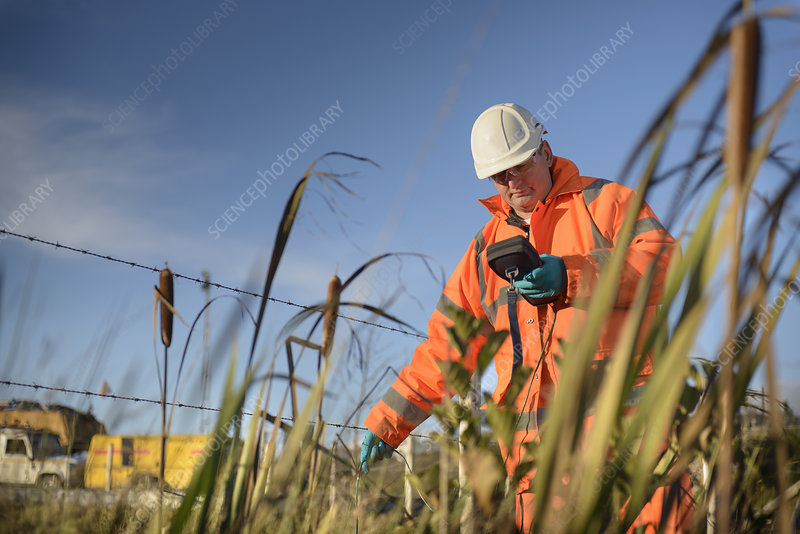 Worker monitoring water at coal mine