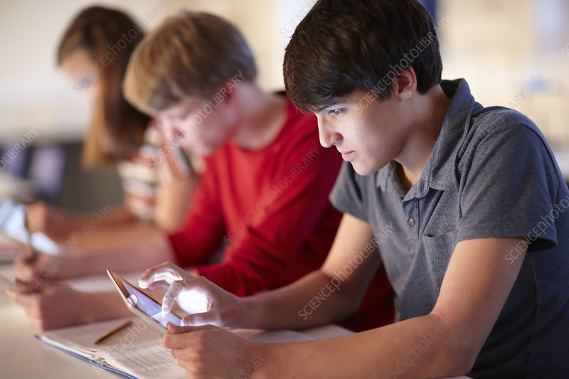 Students using tablet computers in class