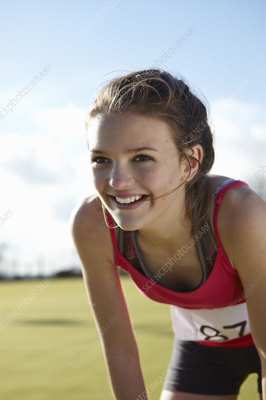 Close up of runners smiling face