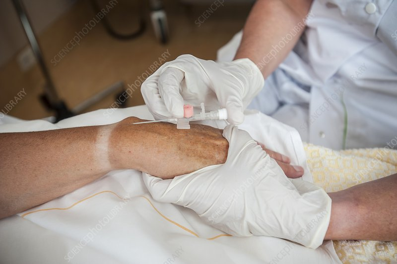 Nurse preparing a patient for an IV line