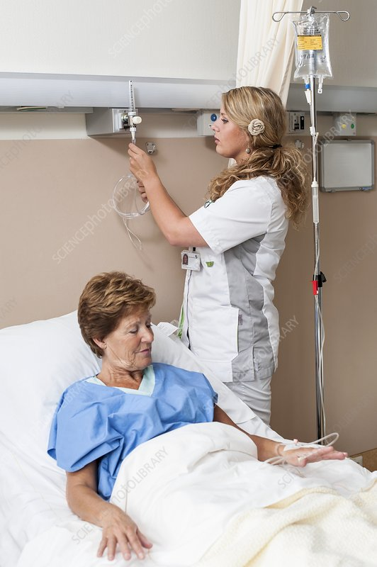 Nurse preparing nasal cannula for patient