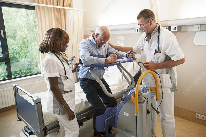 Nurses helping a patient out of bed