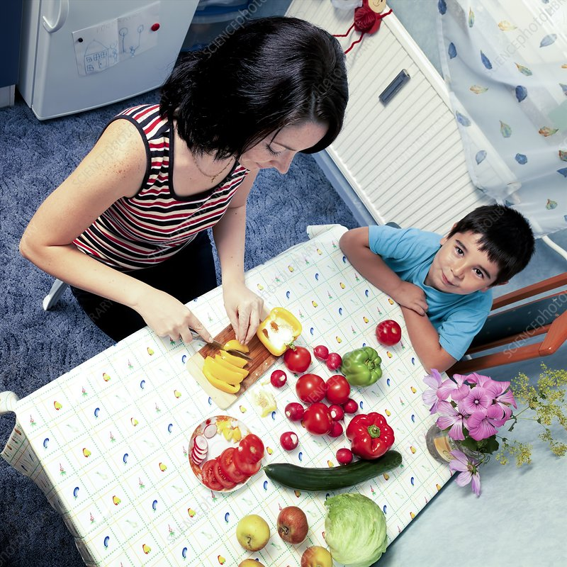 Mother and son preparing vegetables