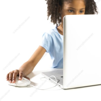 Young girl using a laptop