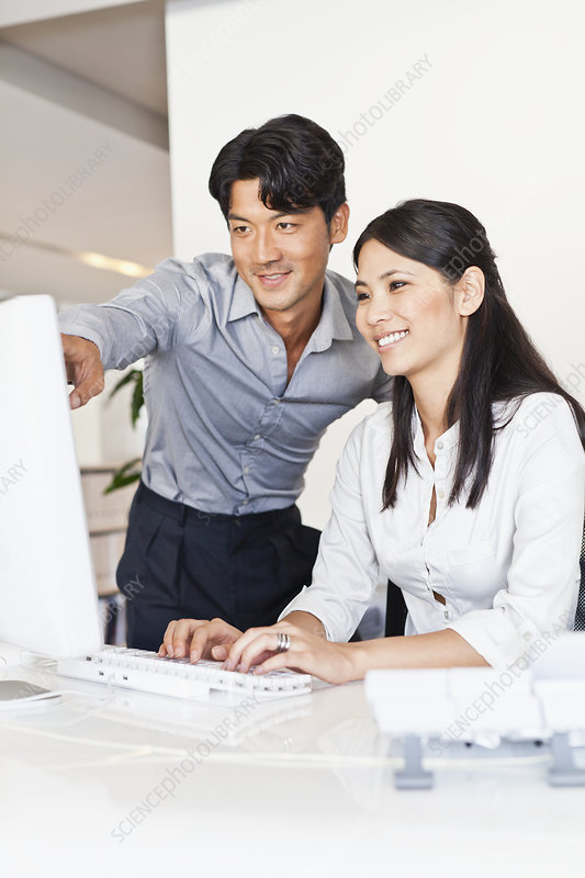 Business people working together at desk