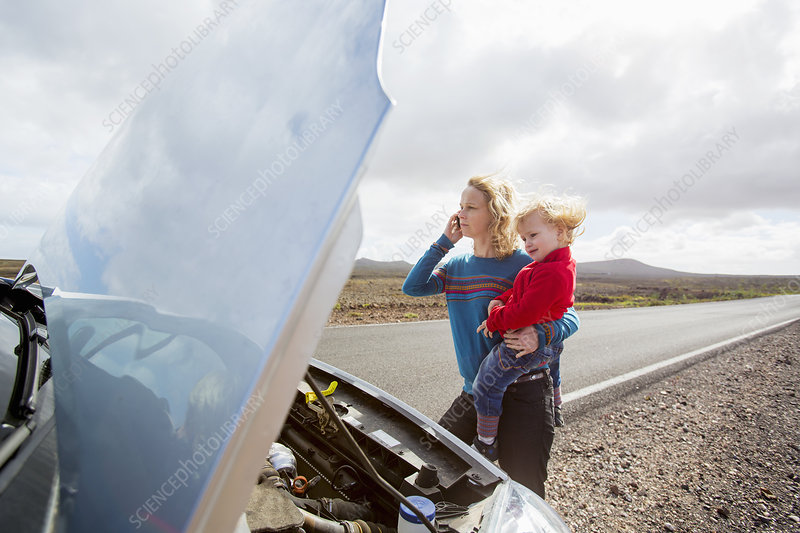 Mother and daughter with broken down car