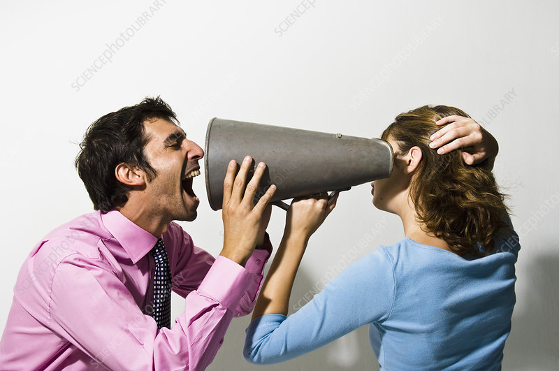 Businessman shouting into colleagues ear