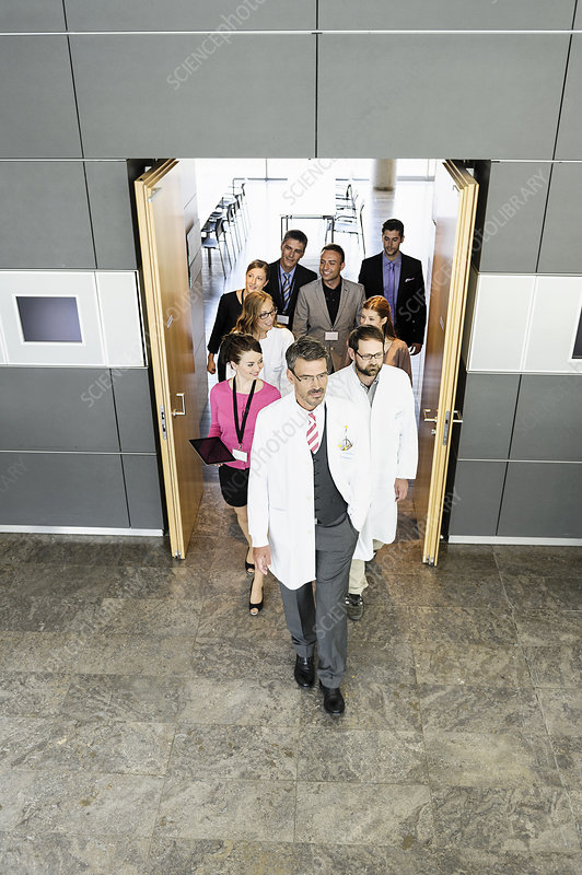 Business people and doctors in doorway