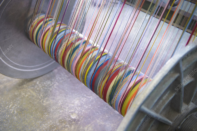 Colourful yarn on loom in textile mill